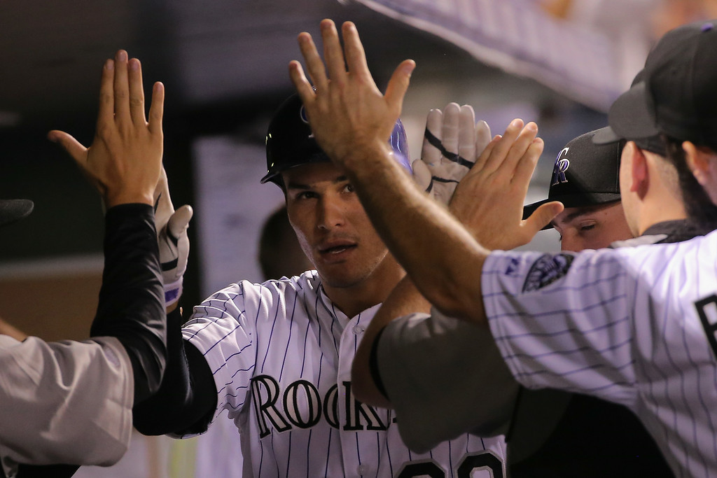 . DENVER, CO - AUGUST 05:  Nolan Arenado #28 of the Colorado Rockies celebrates his solo home run off of Wesley Wright #53 of the Chicago Cubs to tie the score 4-4 in the seventh inning at Coors Field on August 5, 2014 in Denver, Colorado.  (Photo by Doug Pensinger/Getty Images)