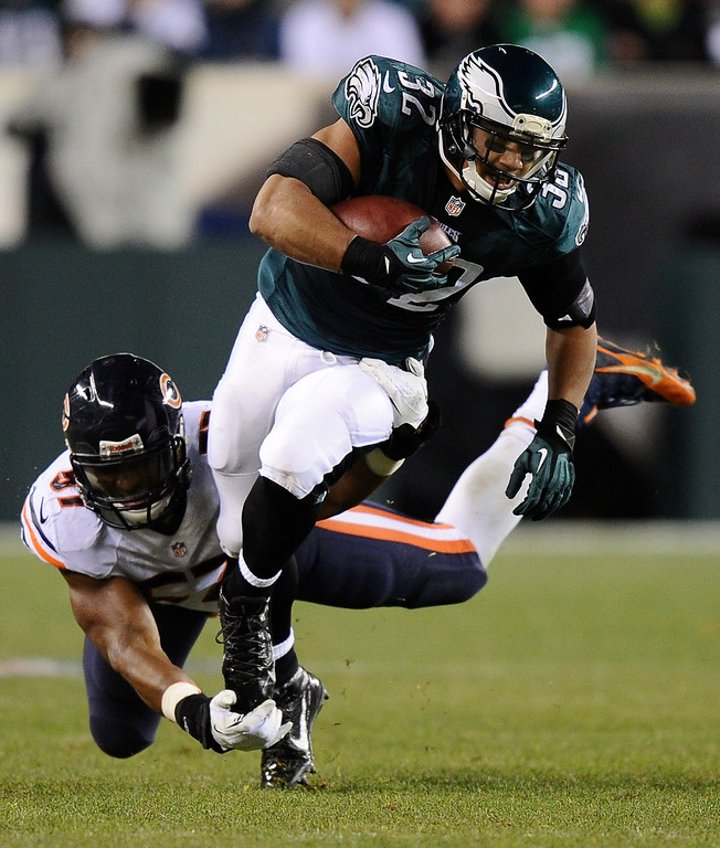 . Chris Polk #32 of the Philadelphia Eagles is tackled by Jon Bostic #57 of the Chicago Bears during the second quarter at Lincoln Financial Field on December 22, 2013 in Philadelphia, Pennsylvania.  (Photo by Maddie Meyer/Getty Images)
