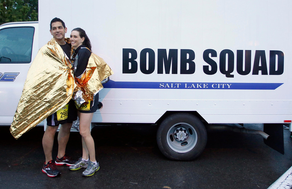 . A couple poses for a photo in front of a bomb squad truck before the Salt Lake City Marathon in Salt Lake City, Utah, April 20, 2013. The Salt Lake City Marathon is the first major marathon since the April 15 bombing at the finish line of the Boston Marathon that claimed three lives.  REUTERS/Jim Urquhart