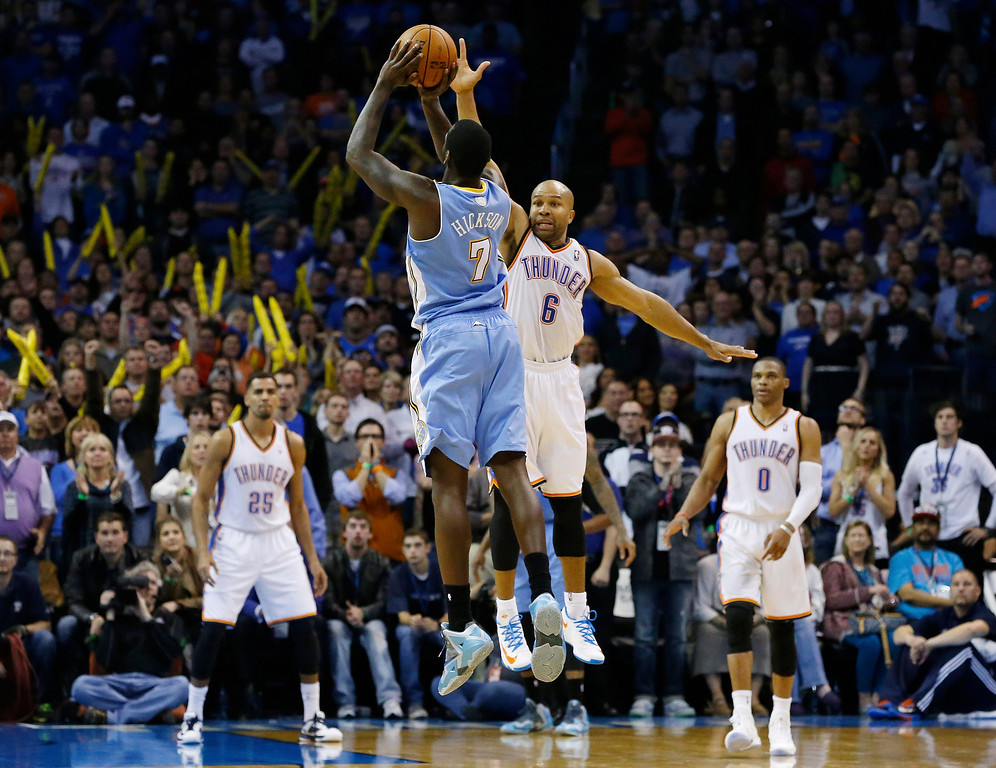 . Denver Nuggets forward J.J. Hickson (7) attempts at shot over Oklahoma City Thunder guard Derek Fisher (6) in the final seconds of the fourth quarter of an NBA basketball game, but misses the basket in Oklahoma City, Monday, Nov. 18, 2013. Oklahoma City won 115-113. (AP Photo/Sue Ogrocki)