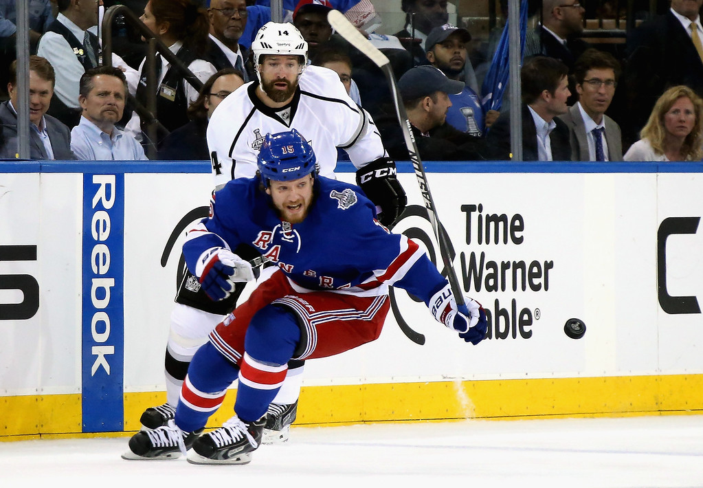 . Derek Dorsett #15 of the New York Rangers and Justin Williams #14 of the Los Angeles Kings chase the puck during the first period of Game Three of the 2014 NHL Stanley Cup Final at Madison Square Garden on June 9, 2014 in New York, New York.  (Photo by Bruce Bennett/Getty Images)