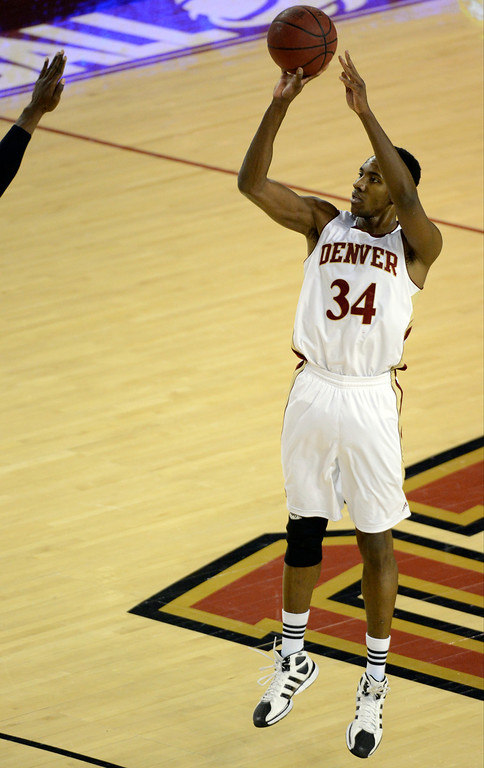 . DENVER, CO. - FEBRUARY 07: Chris Udofia (34) of the Denver Pioneers launches a three pointer against the Seattle Redhawks during the second half February 7, 2013 at Magness Arena. Chris Udofia finished with a game high 23 points. The Denver Pioneers defeated the Seattle Redhawks 72-55. (Photo By John Leyba/The Denver Post)