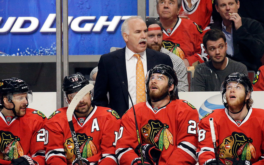 . Chicago Blackhawks head coach Joel Quenneville directs his team during the second period in Game 5 of the Western Conference finals in the NHL hockey Stanley Cup playoffs against the Los Angeles Kings, Wednesday, May 28, 2014, in Chicago. (AP Photo/Nam Y. Huh)