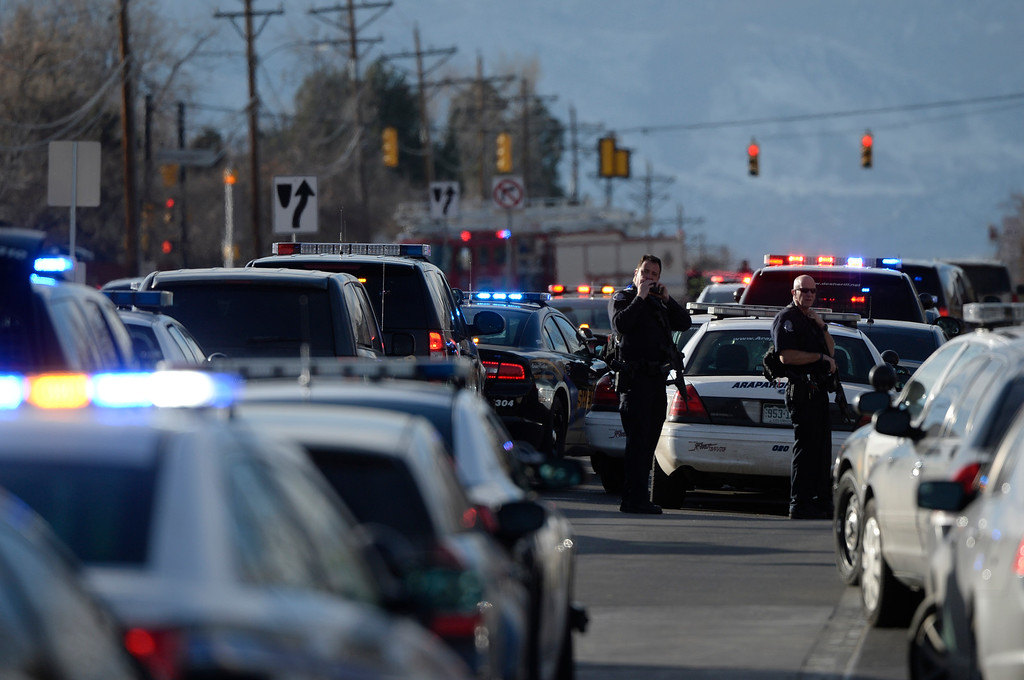 . CENTENNIAL, CO. - DECEMBER 13: Authorities surrounded Arapahoe High School in Centennial, CO December 13, 2013. A student who carried a shotgun into Arapahoe High School and asked where to find a specific teacher opened fire on Friday, wounding two fellow students before apparently killing himself, Arapahoe County Sheriff Grayson Robinson said. (Photo By Craig F. Walker / The Denver Post)