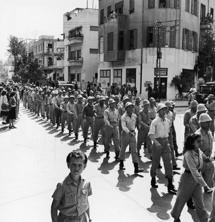 . 1948:  Members of the Jewish militia, the Irgun, marching through the streets of Tel Aviv on the eve of the declaration of the Jewish State.  (Photo by Three Lions/Getty Images)