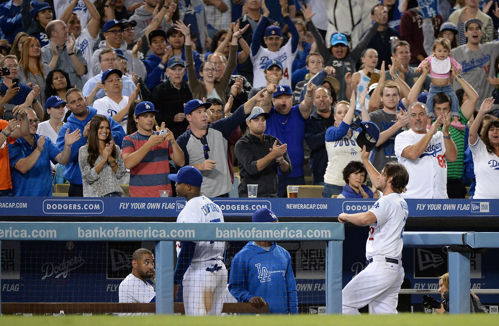 . LOS ANGELES, CA - SEPTEMBER 27:  Clayton Kershaw #22 of the Los Angeles Dodgers receives an ovation as he leaves the game with a 10-0 lead over the Colorado Rockies during the sixth inning at Dodger Stadium on September 27, 2013 in Los Angeles, California.  (Photo by Harry How/Getty Images)