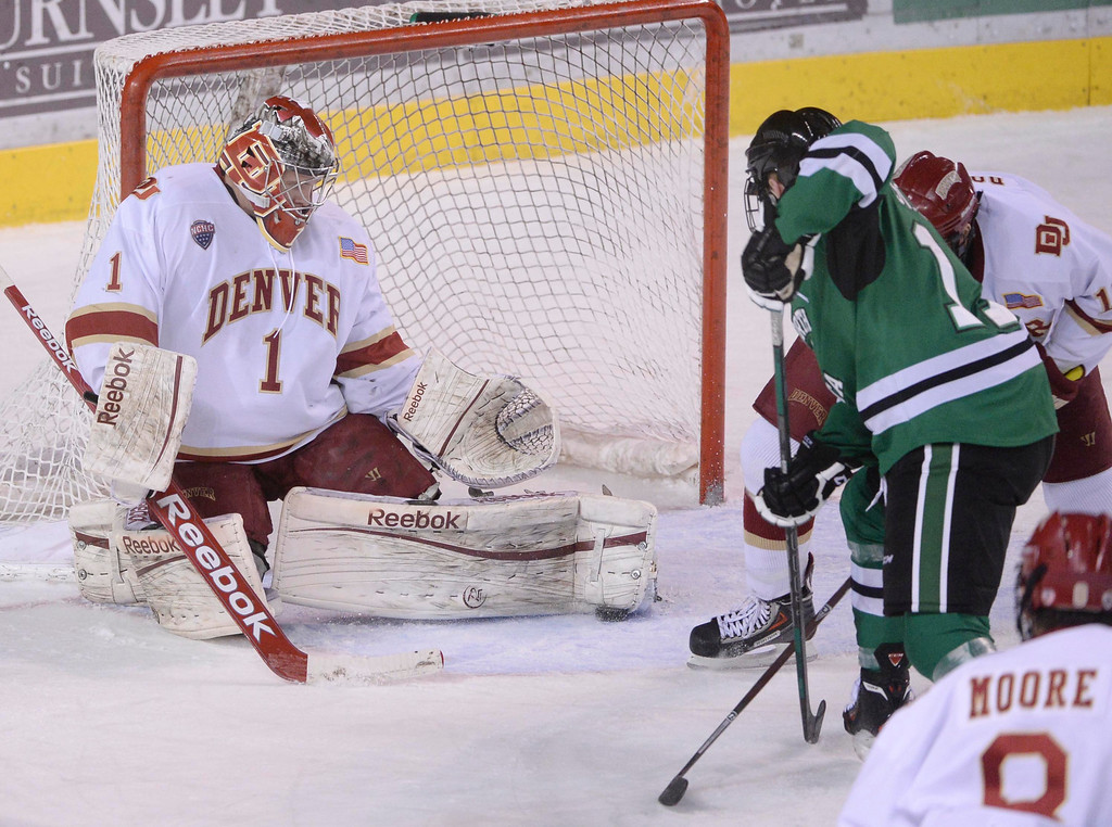 . DENVER, CO. - JANUARY 24:  Denver goalie Sam Brittain trapped the puck under his pad in the second period. The University of Denver hockey team hosted North Dakota at Magness Arena Friday night, January 24, 2014. Photo By Karl Gehring/The Denver Post