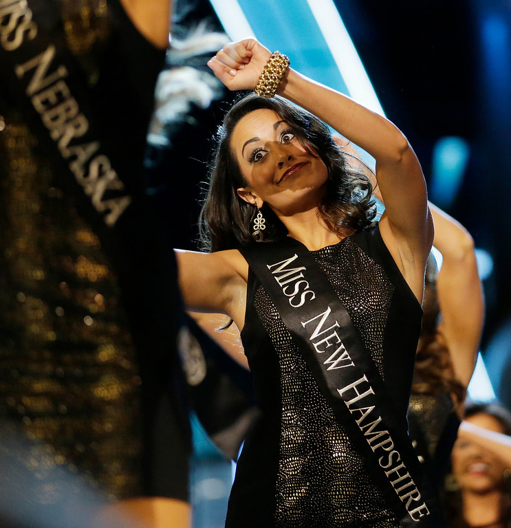 . Miss New Hampshire Samantha Russo dances while walking with other contestants during the Miss America 2014 pageant, Sunday, Sept. 15, 2013, in Atlantic City, N.J. (AP Photo/Julio Cortez)