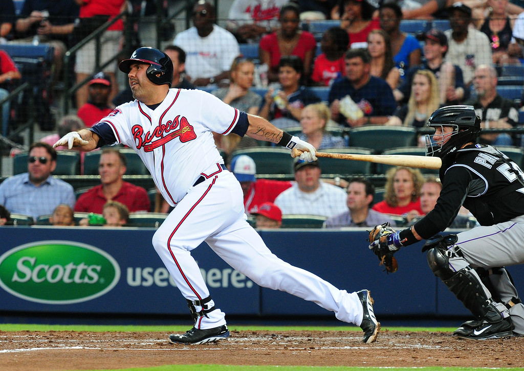 . ATLANTA, GA - MAY 23: Gerald Laird #11 of the Atlanta Braves doubles to knock in a 2nd inning run against the Colorado Rockies at Turner Field on May 23, 2014 in Atlanta, Georgia. (Photo by Scott Cunningham/Getty Images)