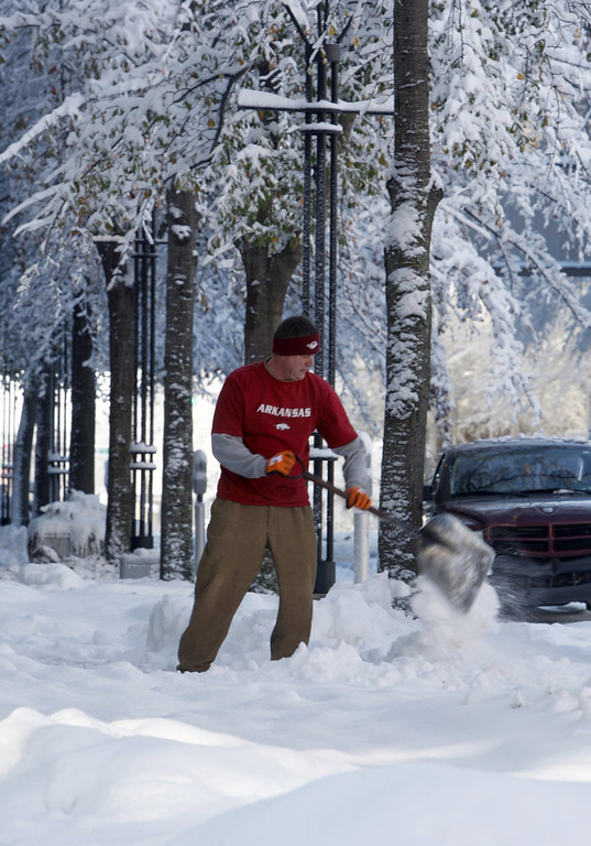 . Arkansas Repertory Theater employee Jeff Roper shovels the sidewalk in front of the theater in downtown Little Rock, Ark., Wednesday, Dec. 26, 2012. (AP Photo/Arkansas Democrat-Gazette, Jeff MItchell)