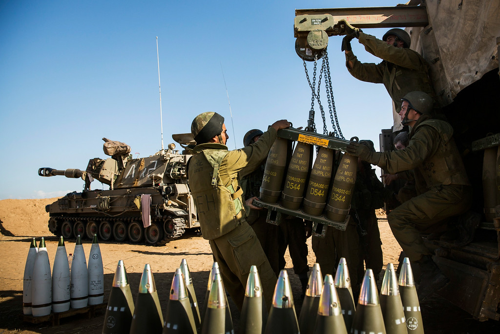 ". Israeli soldiers receive a new crate of artillery shells for firing into Gaza on July 17, 2014 near Sderot, Israel. As the Israeli operation ""Protective Edge\"" enters its tenth day, the body count in Gaza has reach over 200 people. One Israeli has been killed in a Mortar attack.  (Photo by Andrew Burton/Getty Images)"