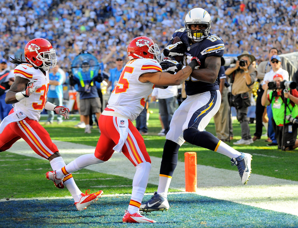 . San Diego Chargers tight end Ladarius Green, right, scores a touchdown as Quintin Demps, center, defends during the first half of an NFL football game, Sunday, Dec. 29, 2013, in San Diego. (AP Photo/Denis Poroy)