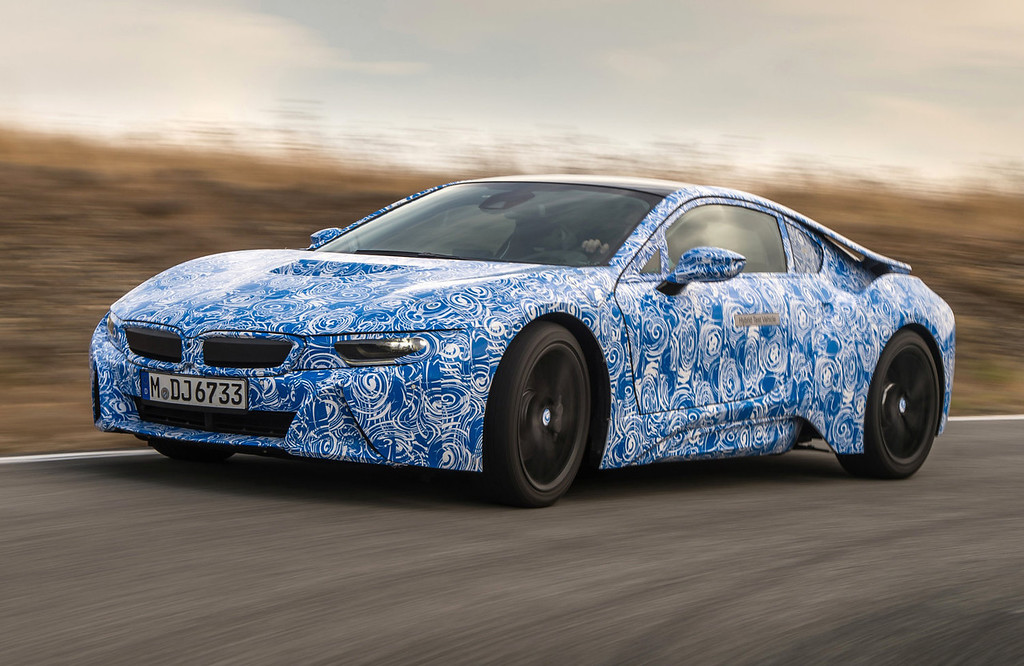 . Photo provided by BMW shows the BMW i8 plug-in hybrid sports car that will be presented during the Frankfurt Auto Show running through Sept. 22, 2013. BMW use carbon fiber parts to achieve light weight and quick acceleration _ zero to 100 kph (0-62 mph) in 4.5 seconds.  (AP Photo/BMW)
