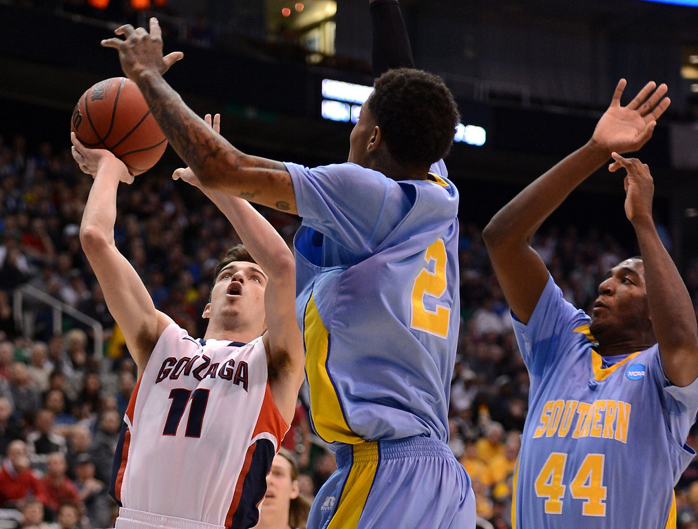 . SALT LAKE CITY, UT - MARCH 21:  David Stockton #11 of the Gonzaga Bulldogs shoots against Derick Beltran #2 of the Southern University Jaguars in the first half during the second round of the 2013 NCAA Men\'s Basketball Tournament at EnergySolutions Arena on March 21, 2013 in Salt Lake City, Utah.  (Photo by Harry How/Getty Images)