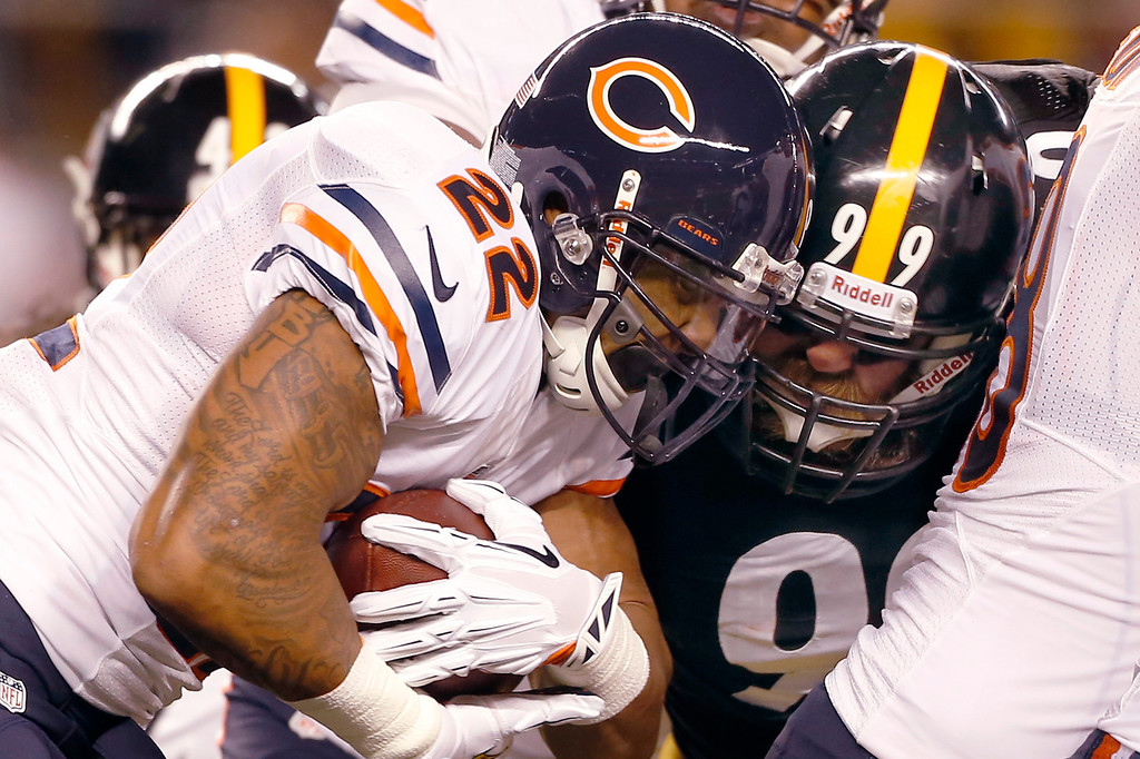 . Chicago Bears running back Matt Forte (22) is hit by Pittsburgh Steelers defensive end Brett Keisel (99) in the first quarter of an NFL football game on Sunday, Sept. 22, 2013, in Pittsburgh. (AP Photo/Keith Srakocic)