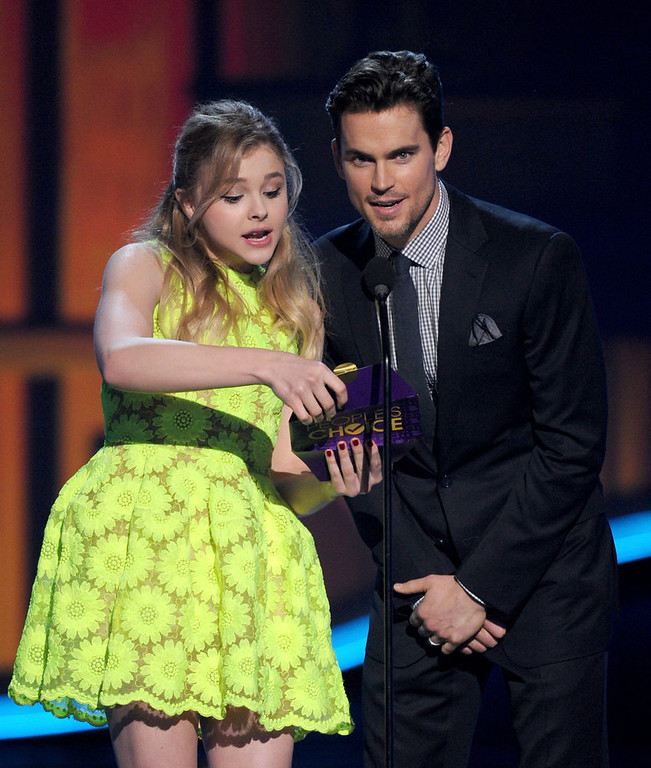 . Actors Chloe Grace Moretz and Matt Bomer speak onstage at the 39th Annual People\'s Choice Awards  at Nokia Theatre L.A. Live on January 9, 2013 in Los Angeles, California.  (Photo by Kevin Winter/Getty Images for PCA)