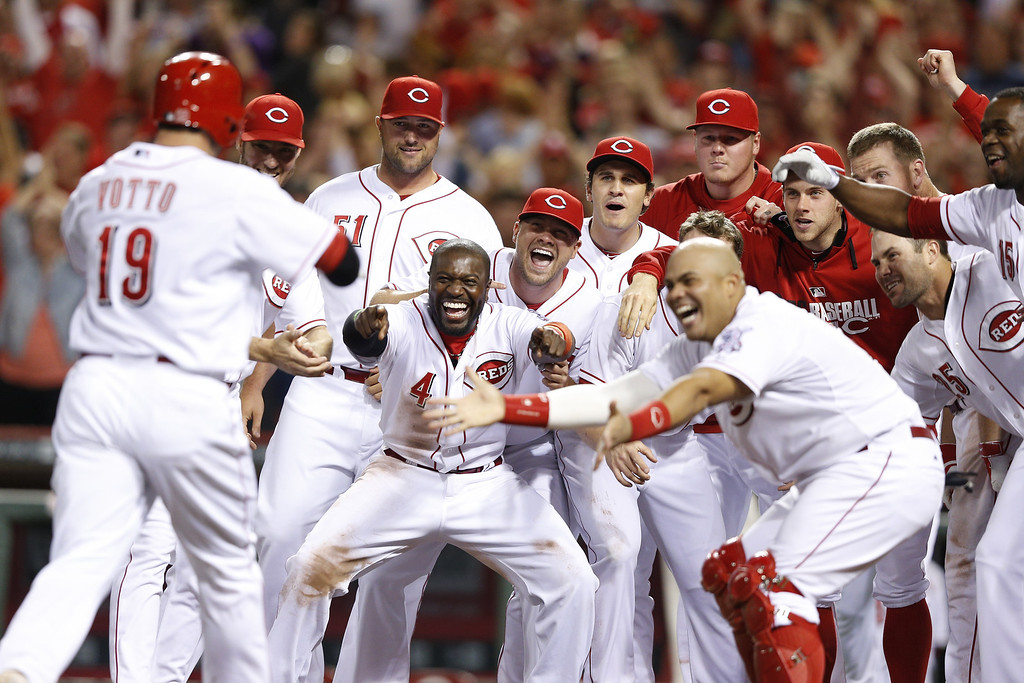 . CINCINNATI, OH - MAY 9: Cincinnati Reds players celebrate after Joey Votto\'s game-winning home run in the bottom of the ninth inning of the game against the Colorado Rockies at Great American Ball Park on May 9, 2014 in Cincinnati, Ohio. The Reds won 4-3. (Photo by Joe Robbins/Getty Images)
