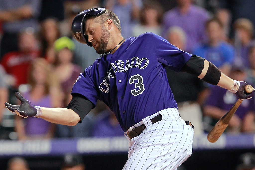 . Colorado Rockies\' Michael Cuddyer fouls a pitch before popping out to end his 27-game hitting streak, in the ninth inning against the Los Angeles Dodgers in a baseball game Tuesday, July 2, 2013 in Denver. The Dodgers won 8-0. (AP Photo/Barry Gutierrez)