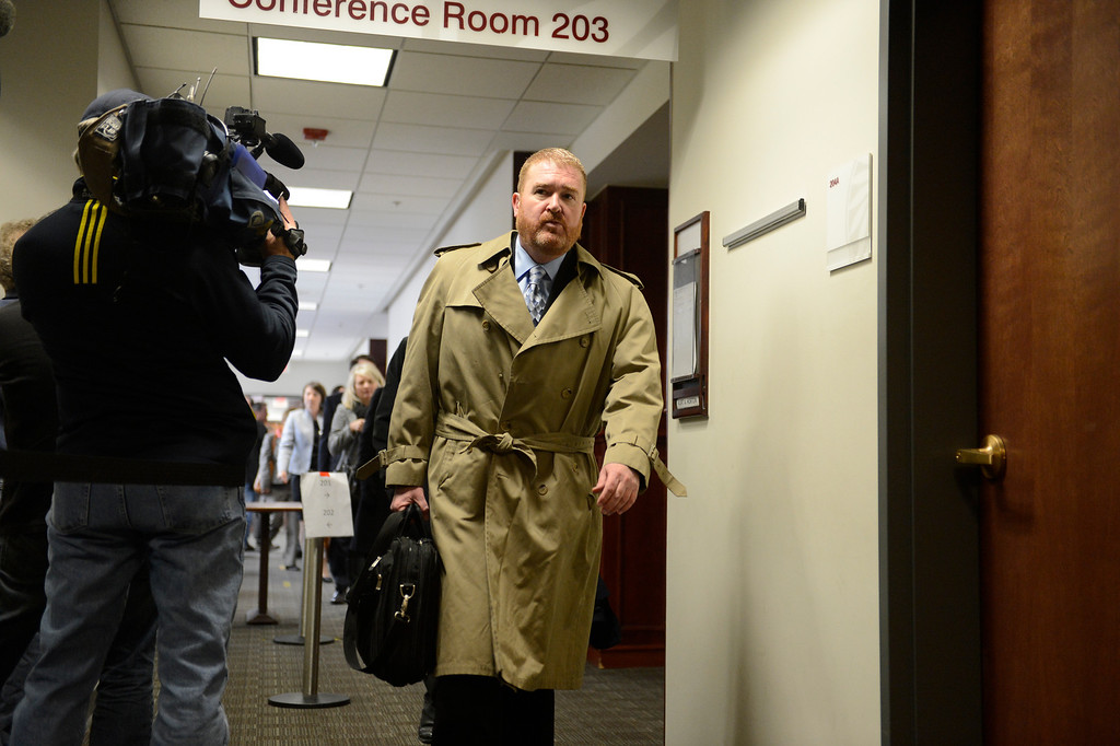 . Defense attorney Daniel King leaves the courtroom on the second floor of the Arapahoe County Courthouse, Tuesday March 12, 2013. District Court Judge William Sylvester entered a Not Guilty plea on behalf of Holmes. The trial begins August 5, 2013. (Photo By Joe Amon/The Denver Post)