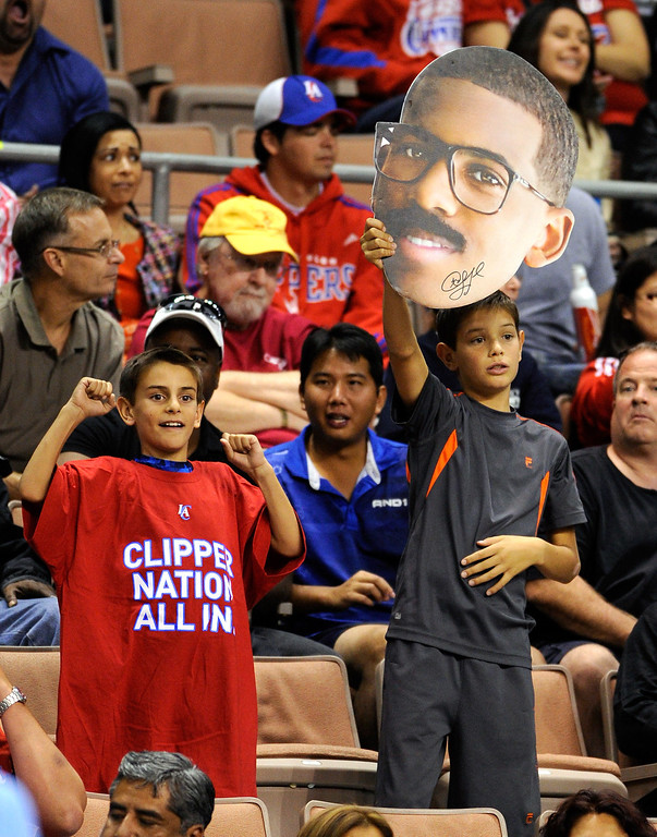 . A fan of the Los Angeles Clippers holds up a cardboard cutout of Chris Paul #3 of the Clippers during the team\'s preseason game against the Denver Nuggets at the Mandalay Bay Events Center on October 19, 2013 in Las Vegas, Nevada. Los Angeles won 118-111 in overtime.   (Photo by Ethan Miller/Getty Images)