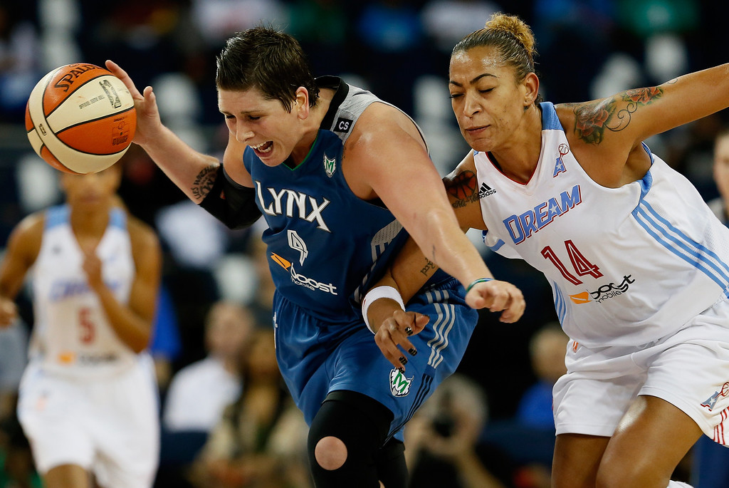 . ATLANTA, GA - OCTOBER 10:  Janel McCarville #4 of the Minnesota Lynx steals the ball from Erika de Souza #14 of the Atlanta Dream during Game Three of the 2013 WNBA Finals at Philips Arena on October 10, 2013 in Atlanta, Georgia.    (Photo by Kevin C. Cox/Getty Images)