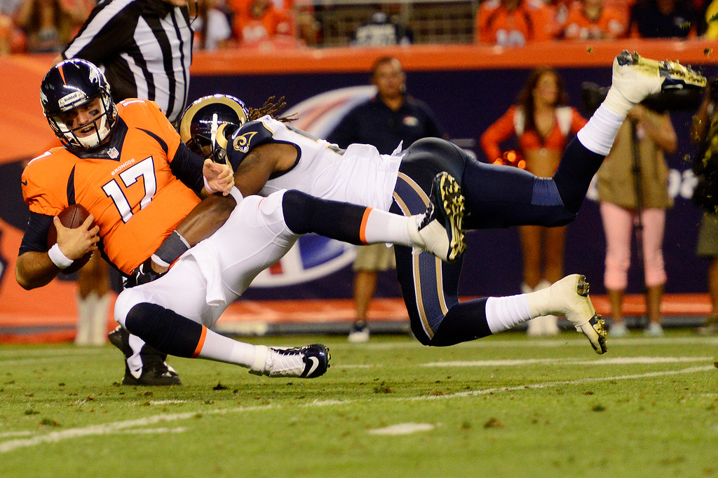 . DENVER, CO - AUGUST 24: Ray-Ray Armstrong (50) of the St. Louis Rams sacks Brock Osweiler (17) of the Denver Broncos during the second half of action of an NFL preseason game at Sports Authority Field at Mile High on August 24, 2013. This is the third game of the preseason for the Broncos. (Photo by AAron Ontiveroz/The Denver Post)