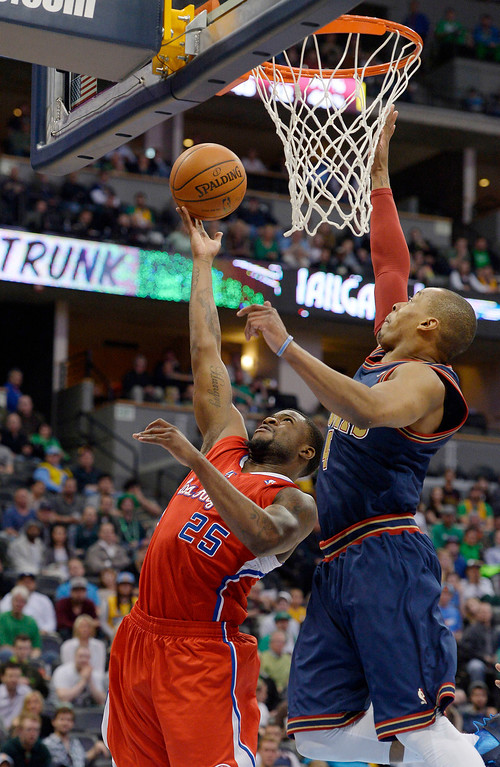 . DENVER, CO - MARCH 17: Los Angeles Clippers guard Reggie Bullock (25) gets his shot blocked by Denver Nuggets guard Randy Foye (4) late in the fourth quarter March 17, 2014 at Pepsi Center. The Denver Nuggets defeated the Los Angeles Clippers 110-100. (Photo by John Leyba/The Denver Post)