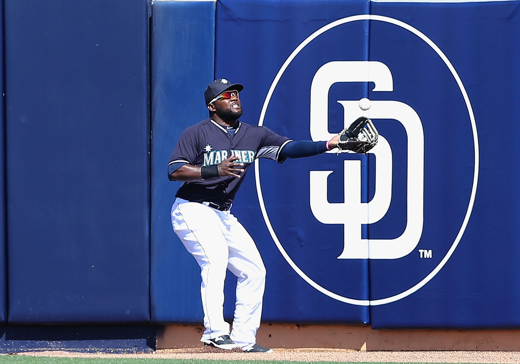 . Outfielder Abraham Almonte #36 of the Seattle Mariners catches a fly ball out against the Colorado Rockies during the spring training game at Peoria Stadium on March 3, 2014 in Peoria, Arizona.  (Photo by Christian Petersen/Getty Images)