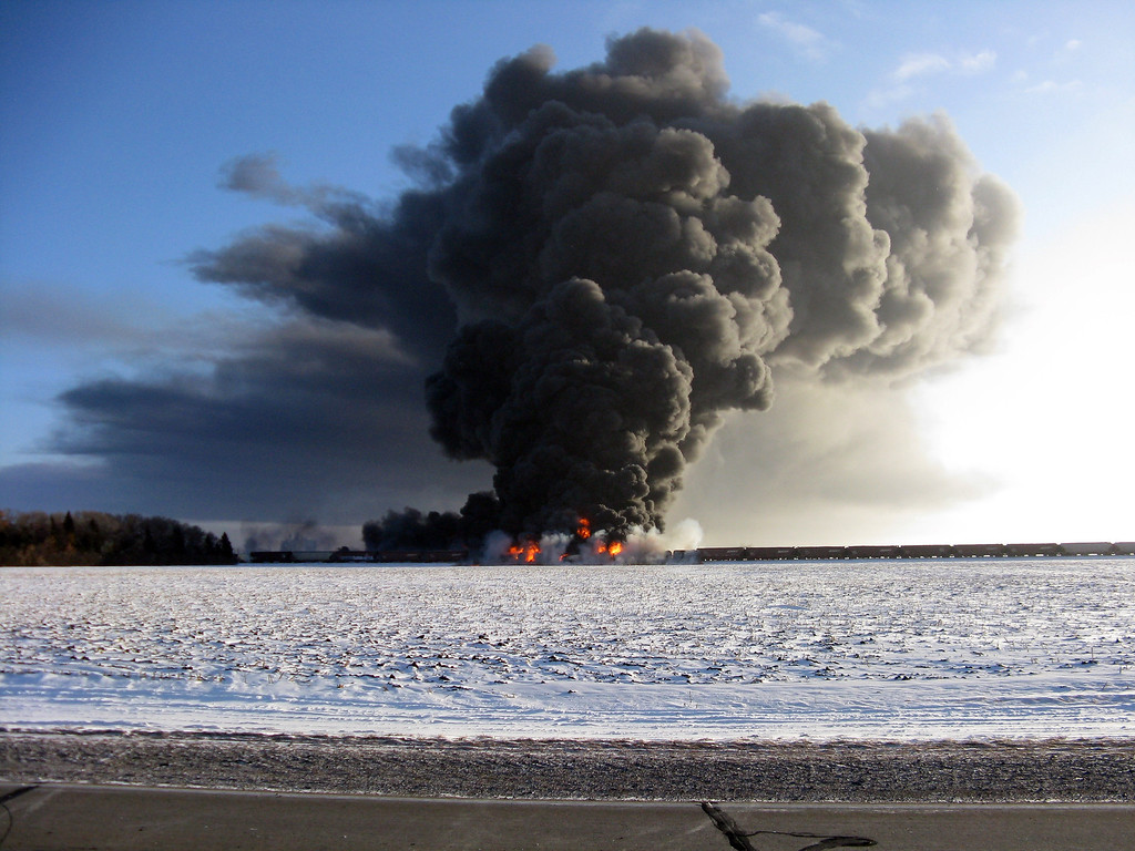 . This photo provided by Cass County Commissioner Ken Pawluk shows a train derailment and fire west of Casselton, N.D., Monday, Dec. 30, 2013. No one has been reported hurt in the derailment or fire. By late Monday afternoon, the smoke plume was diminishing and was staying mostly away from town. (AP Photo/Ken Pawluk)