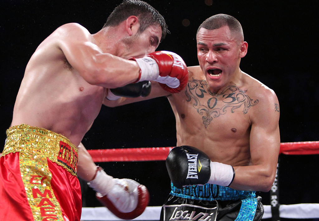 . 3. Mike Alvarado vs. Mauricio Herrera. In April of 2012, Alvarado extended his perfect record to 33-0 with a unanimous-decision victory over top light welterweight contender Herrera in Las Vegas. Alvarado pelted Herrera with so many hard punches that his eye nearly swelled shut. (Photo by Chris Farina - Top Rank)
