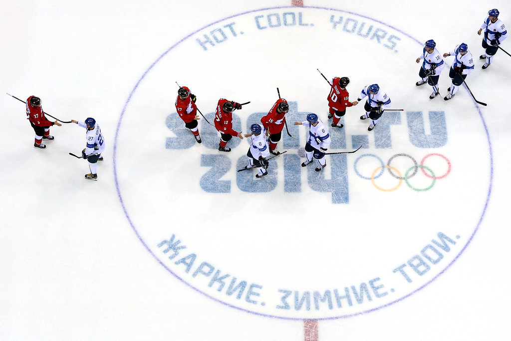 . Team Canada shakes hands with Team Finland  after defeating Finland 2 to 1 in overtime of the Men\'s Ice Hockey Preliminary Round Group B game on day nine of the Sochi 2014 Winter Olympics at Bolshoy Ice Dome on February 16, 2014 in Sochi, Russia.  (Photo by Bruce Bennett/Getty Images)