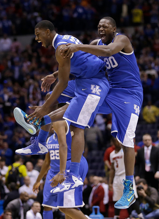 . Kentucky\'s Alex Poythress and Aaron Harrison celebrate after an NCAA Midwest Regional semifinal college basketball tournament game against the Louisville Saturday, March 29, 2014, in Indianapolis. Kentucky won 74-69. (AP Photo/David J. Phillip)