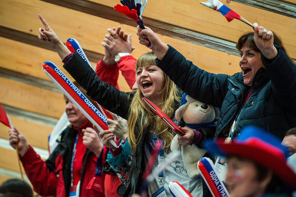 . Russian fans cheer during the four-man bobsled competition at Sanki Sliding Center during the 2014 Sochi Olympics Sunday February 23, 2014. They won the bronze medal with a cumulative time of 3:40.99. 