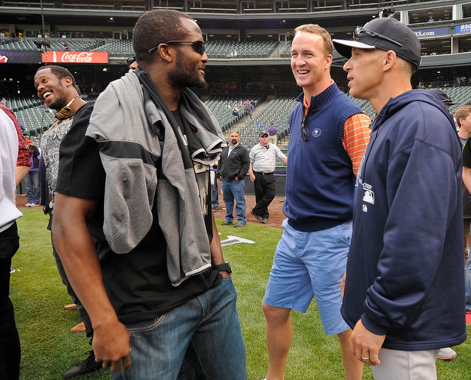 . DENVER, CO. - MAY 07: Denver Broncos Champ Bailey (L) and Peyton Manning Talks with manager Joe Girardi (28) of the New York Yankees duringn batting practice May 7, 2013 at Coors Field. (Photo By John Leyba/The Denver Post)