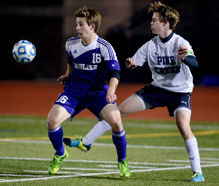 . Matteo Wilczak of Boulder High School (16) and Sean Cleary of Pine Creek High School (13) fight for the control of the ball in the first half. (Photo by Hyoung Chang/The Denver Post)