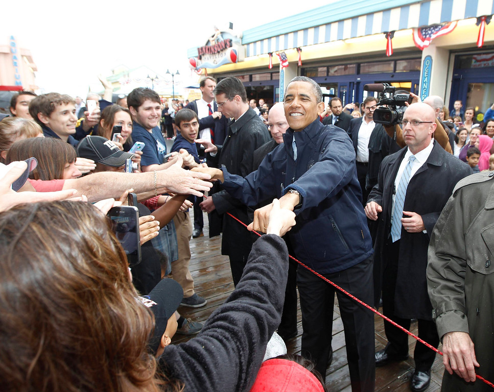 . U.S. President Barack Obama meets holidaymakers on the boardwalk at Point Pleasant in New Jersey May 28, 2013. REUTERS/Jason Reed