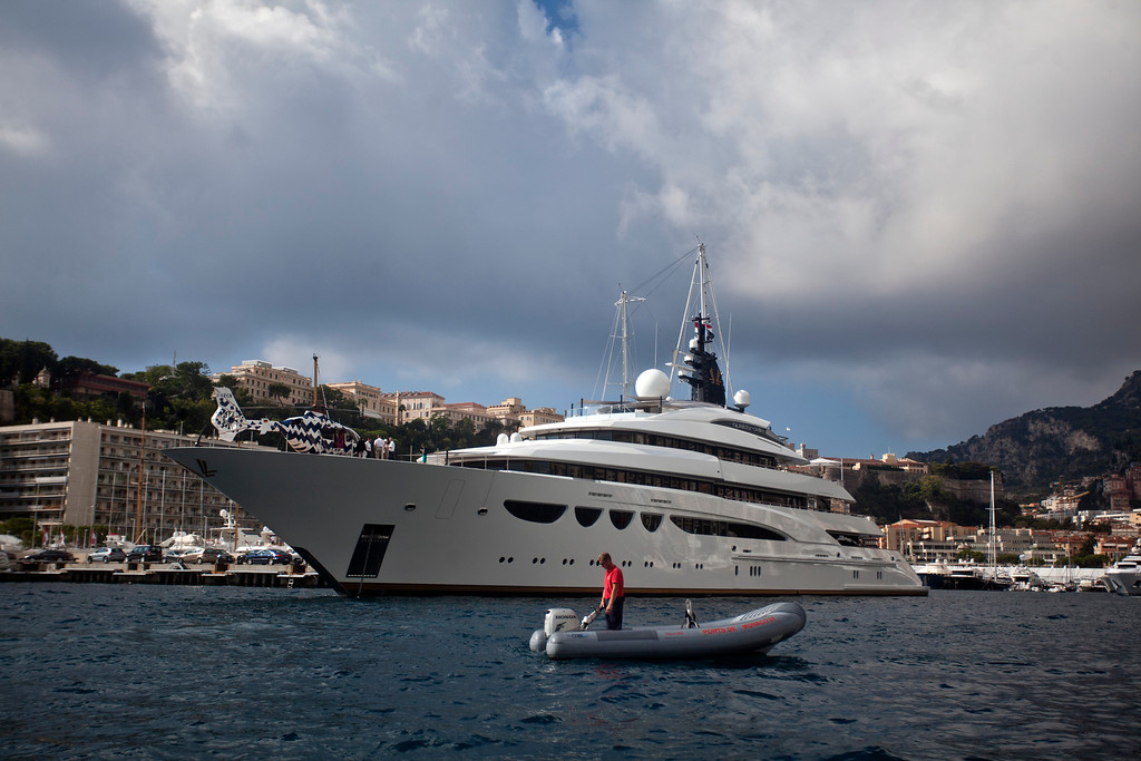 . A Eurocopter helicopter stands on the deck of the luxury superyacht Quattroelle, designed by Nuvolari Lenard Design in Italy, as it sits moored in the harbor during the Monaco Yacht Show (MYS) in Monaco, France, on Wednesday, Sept. 25, 2013. Photographer: Balint Porneczi/Bloomberg