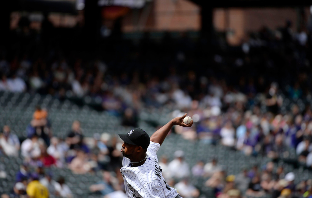 . Colorado Rockies starting pitcher, Juan Nicasio, pitches against the Chicago White Sox at Coors Field Wednesday afternoon, April 09, 2014. (Photo By Andy Cross / The Denver Post)