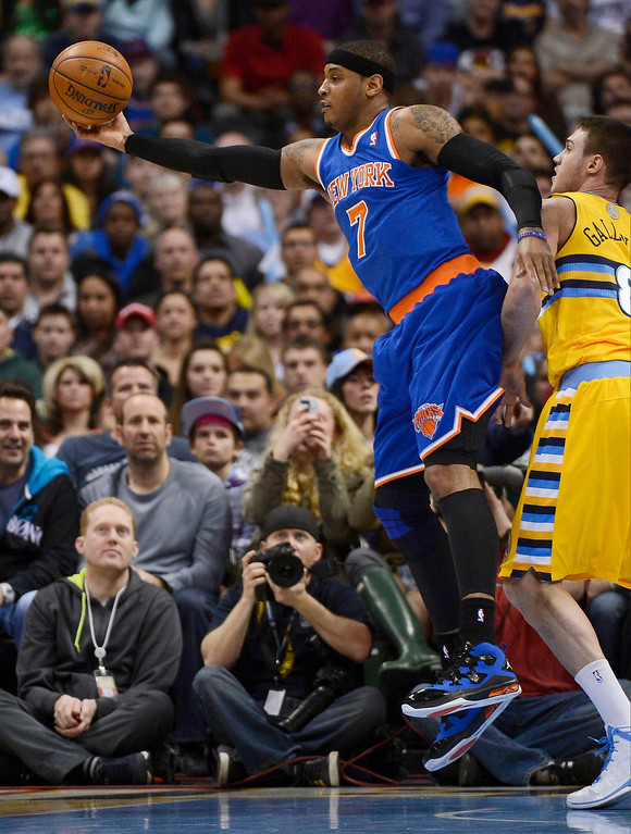 . Carmelo Anthony (7) of the New York Knicks reaches out for a rebound during the first quarter March 13,  2013 at Pepsi Center. (Photo By John Leyba/The Denver Post)