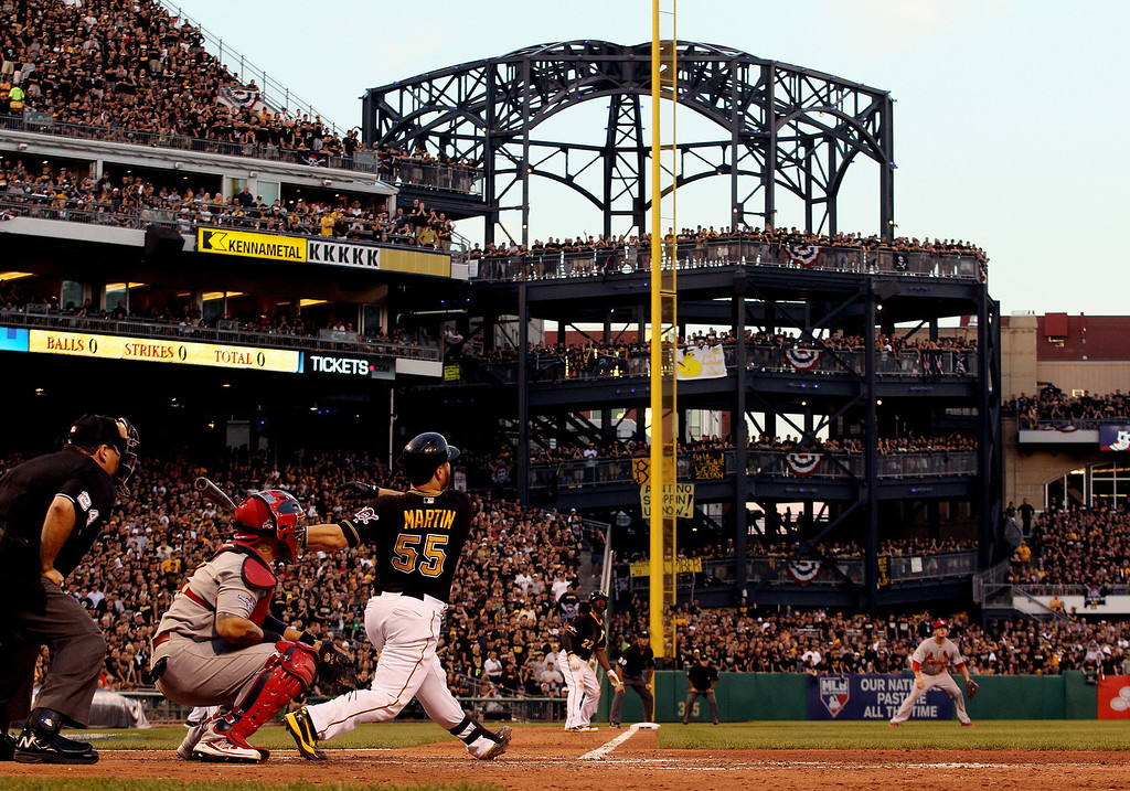 . Russell Martin #55 of the Pittsburgh Pirates bats against the St. Louis Cardinals during Game Three of the National League Division Series at PNC Park on October 6, 2013 in Pittsburgh, Pennsylvania.  (Photo by Jared Wickerham/Getty Images)