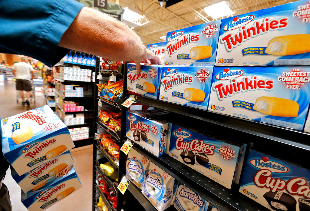 . Twinkies are placed on the shelf at a Fry\'s Food Stores, Monday, July 15, 2013 in Gilbert, Ariz. (AP Photo/Matt York)