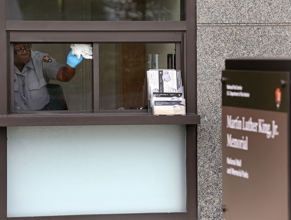 . A U.S. Park Service employee cleans the windows inside the information center at the Martin Luther King Memorial on the morning after a bipartisan bill was passed by the House and the Senate to reopen the government and raise the debt limit, on October 17, 2013 in Washington, DC.   (Photo by Mark Wilson/Getty Images)