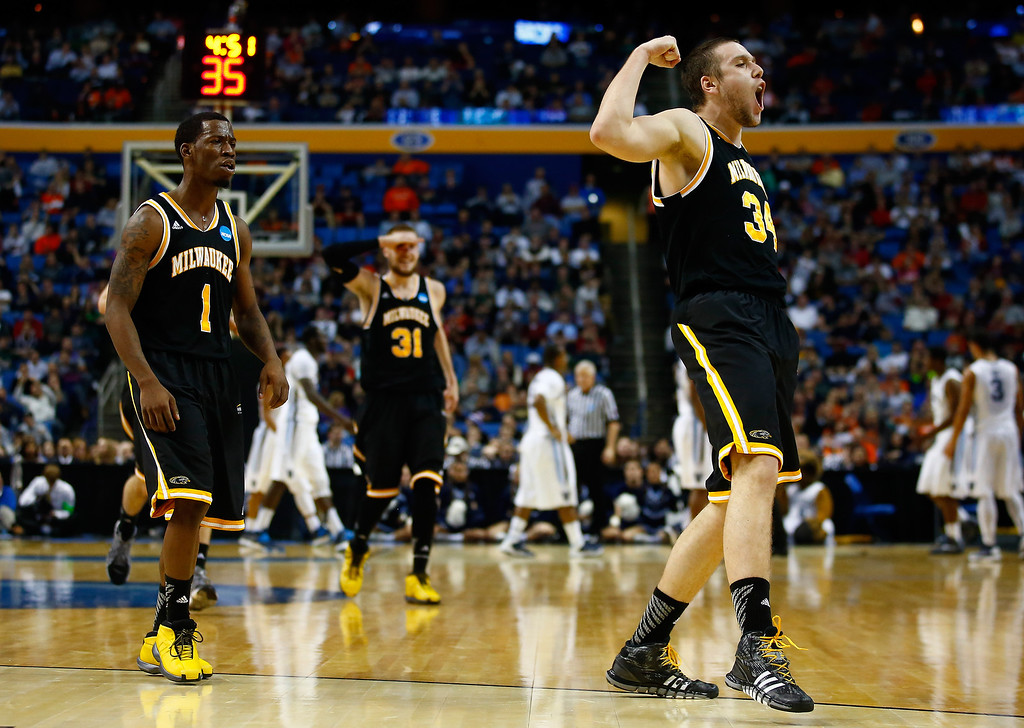 . BUFFALO, NY - MARCH 20: Austin Arians #34 and Jordan Aaron #1 of the Milwaukee Panthers celebrate against the Villanova Wildcats during the second round of the 2014 NCAA Men\'s Basketball Tournament at the First Niagara Center on March 20, 2014 in Buffalo, New York.  (Photo by Jared Wickerham/Getty Images)