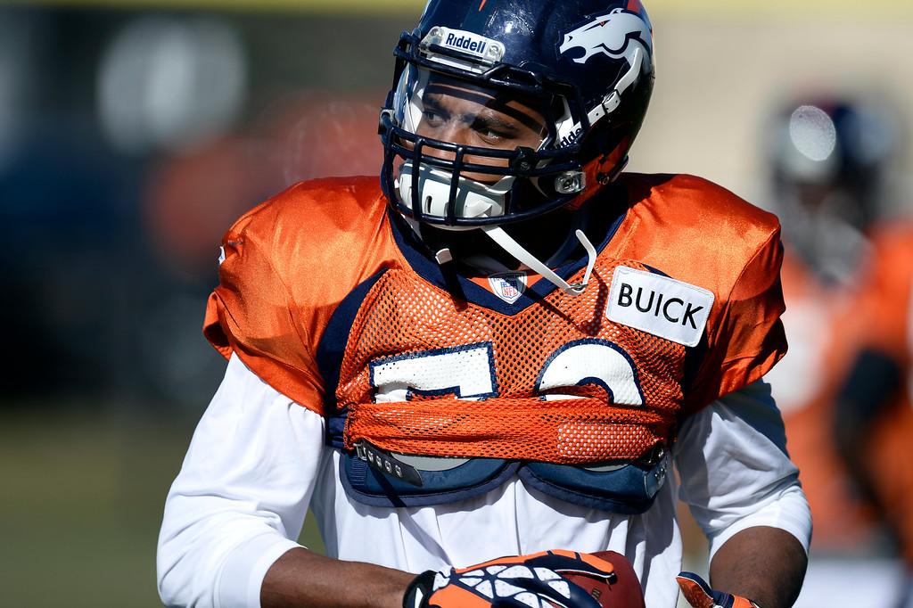 . Denver Broncos outside linebacker Wesley Woodyard (52) runs through drills during practice November 6, 2013 at Dove Valley. (Photo by John Leyba/The Denver Post)