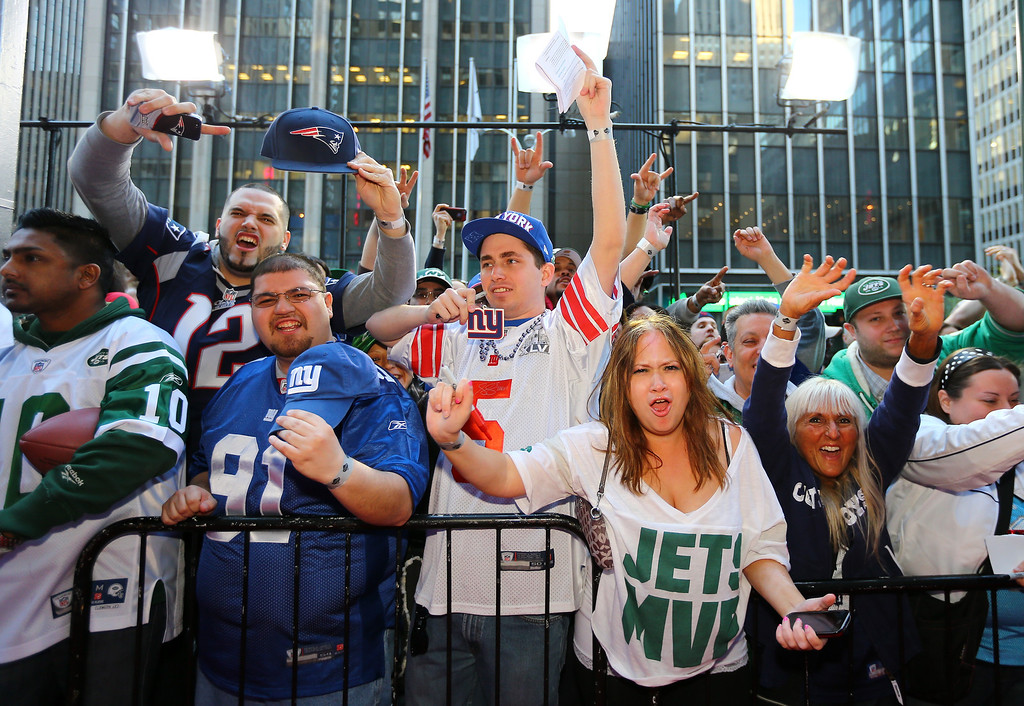 . Fans show support for their respected team outside of Radio City Music Hall during the first round of the 2013 NFL Draft at Radio City Music Hall on April 25, 2013 in New York City.  (Photo by Al Bello/Getty Images)