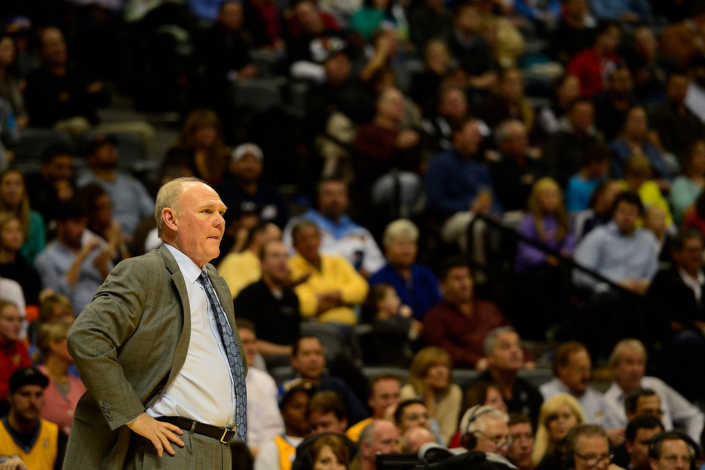 . Denver Nuggets head coach George Karl watches teh action against the Toronto Raptors during the first half at the Pepsi Center on Monday, December 3, 2012. AAron Ontiveroz, The Denver Post
