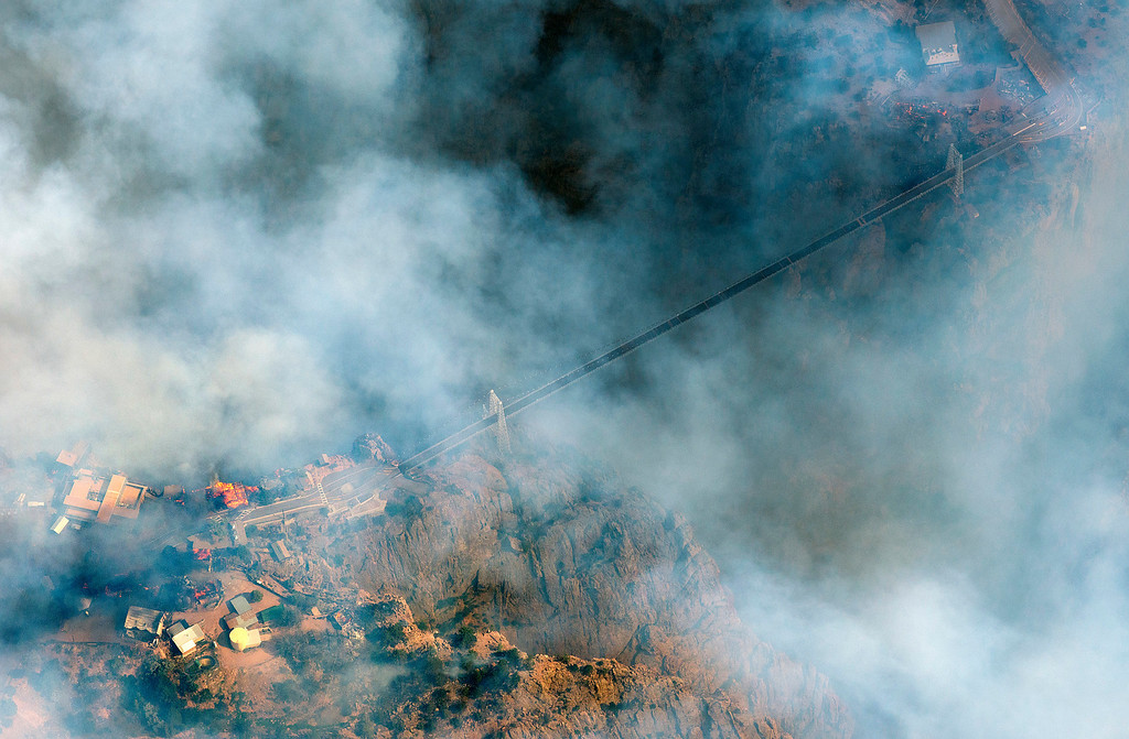 . Fires burn structures near both ends of the Royal Gorge Bridge on Tuesday, June 11, 2013. The Royal Gorge Fire has burned about 300 acres south of the Royal Gorge Bridge and Arkansas River. (John Wark, Special to The Denver Post)