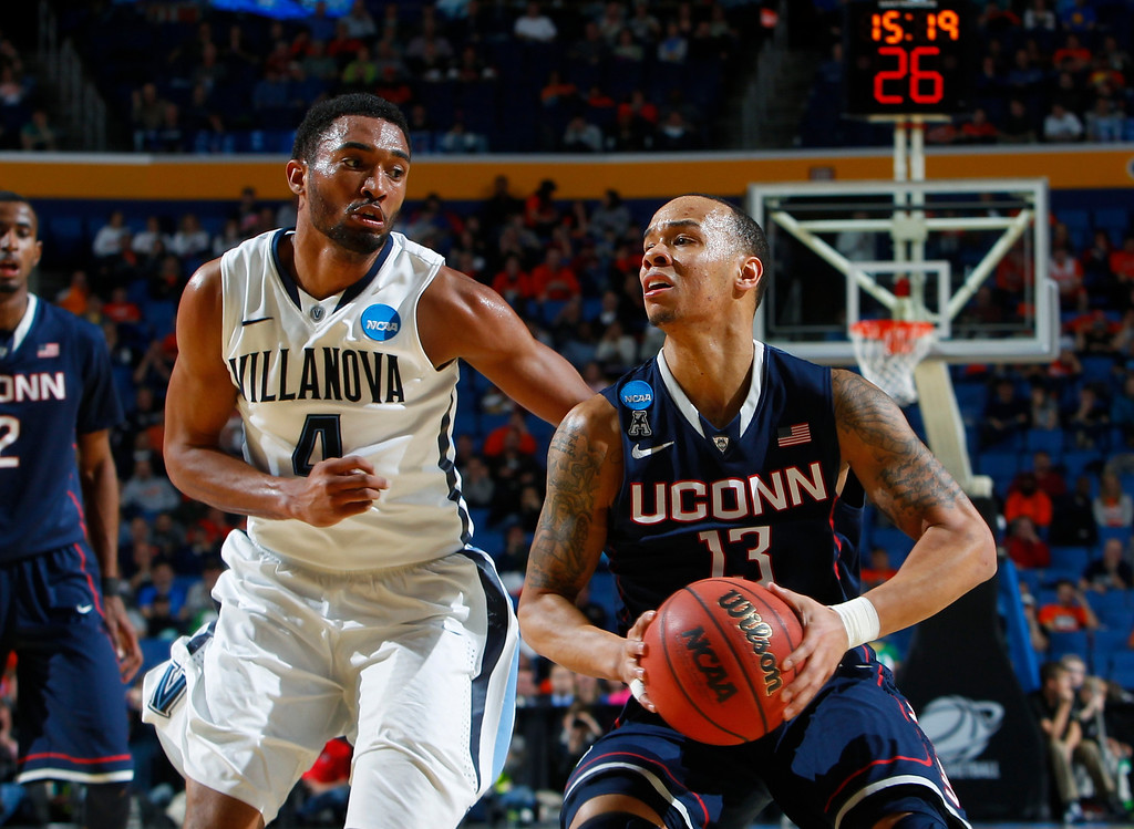 . Villanova\'s Darrun Hilliard II (4) defends Connecticut\'s Shabazz Napier (13) during the second half of a third-round game in the NCAA men\'s college basketball tournament in Buffalo, N.Y., Saturday, March 22, 2014. (AP Photo/Bill Wippert)