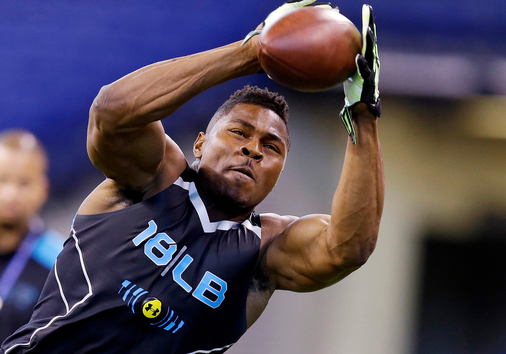 . Buffalo linebacker Khalil Mack makes a catch as he runs a drill at the NFL football scouting combine in Indianapolis, Monday, Feb. 24, 2014. (AP Photo/Michael Conroy)