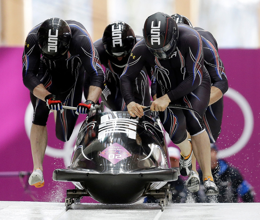 . The team from the United States USA-1, with Steven Holcomb, Curtis Tomasevicz, Steven Langton and Christopher Fogt, start their third run during the men\'s four-man bobsled competition final at the 2014 Winter Olympics, Sunday, Feb. 23, 2014, in Krasnaya Polyana, Russia. (AP Photo/Natacha Pisarenko)